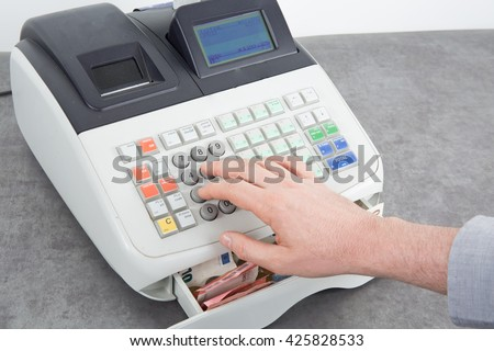 Hand open the cash register and giving change in euro from the till - stock photo
