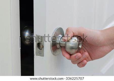 hand open the white door - stock photo