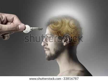 hand opening man's mind with a key - stock photo