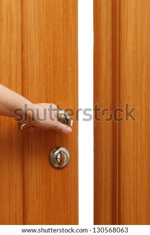 Hand opening the door. Vertical format - stock photo
