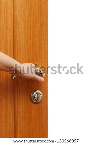 Hand opening the door. Vertical format over a white background with copy space - stock photo