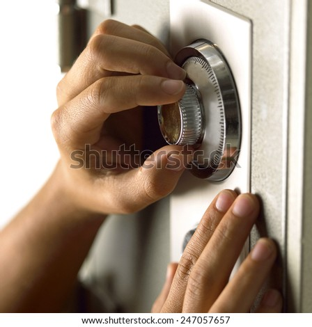 hand opens a safe - stock photo