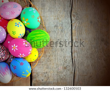 Hand painted colorful Easter eggs, shallow focus - stock photo