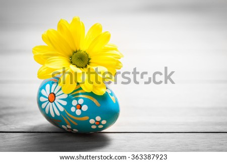 Hand painted Easter egg and spring daisy flower on wood. Rustic minimalist composition, vintage - stock photo