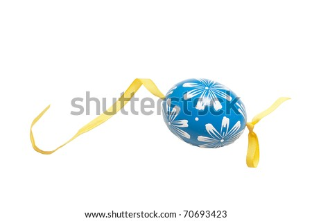 Hand-painted easter egg on a ribbon - stock photo