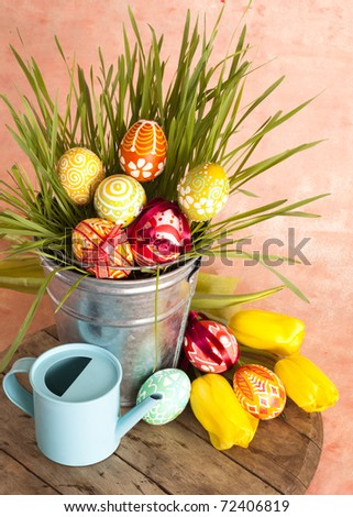 Hand painted Easter eggs and green grass - stock photo