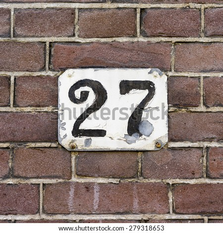 hand painted house number twenty seven. - stock photo