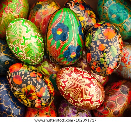 Hand-painted Wooden Easter Eggs in a Box Decorated in Traditional Indian Floral Design - stock photo