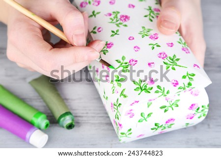 Hand paints on hand made casket and art materials - stock photo