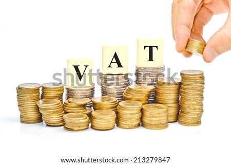 hand paying VAT (Value Added Tax) on Stacks of Gold Coins with isolated background - stock photo