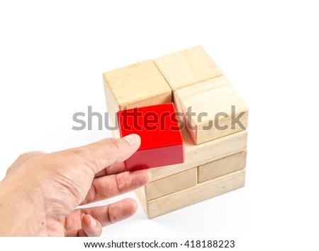 hand pick up wooden cube block to make structure isolated on white background,planning in business concept - stock photo