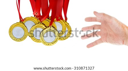 Hand picking a gold medals - stock photo