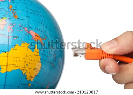Hand plugging a network cable to the world isolated on white background  - stock photo