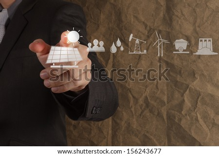 hand point solar cell icon with crumpled recycle paper background as concept - stock photo
