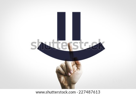 Hand Pointing in a Transparent Board a Smiley - stock photo