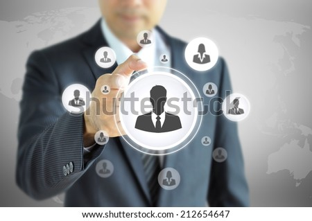 Hand pointing to businessman icon  - HR, recruitment and chosen concept - stock photo