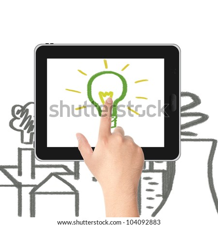 Hand pointing to the hand draw green light bulb on tablet PC screen with factories and Nuclear plant pollution. Concept for eco and global warming - stock photo
