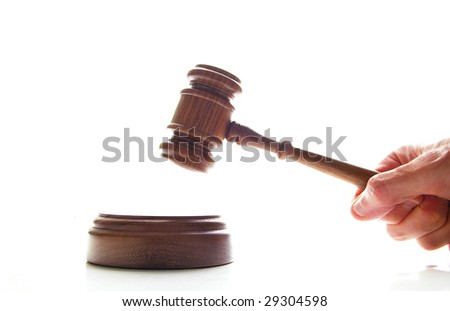 hand pounding a judges court gavel, isolated on white - stock photo