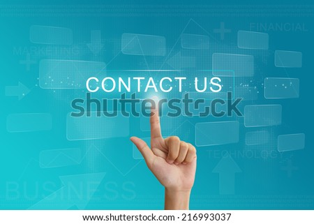 hand press on contact us button on virtual screen - stock photo