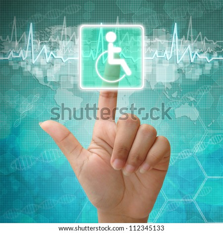 Hand press on Disabled Symbol ,medical background - stock photo