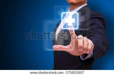Hand press on First Aid sign  - stock photo