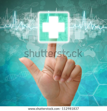 Hand press on First Aid Symbol , medical background - stock photo