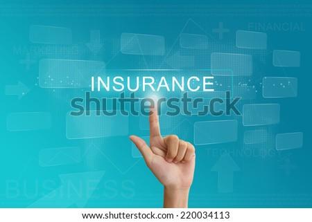 hand press on insurance button on virtual screen - stock photo