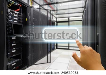 Hand press on window icon in data center server room. - stock photo