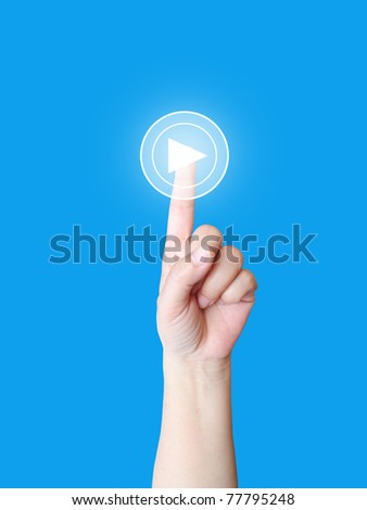 Hand press play button - stock photo