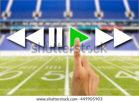 hand pressed to play video the football rugby american play online - stock photo