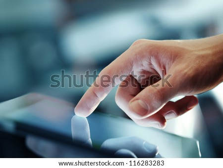 hand presses on screen digital tablet - stock photo