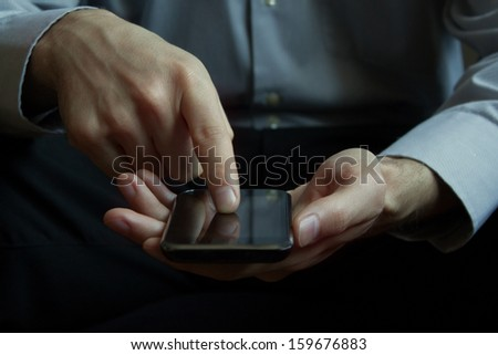 Hand presses on screen mobile smart phone - stock photo
