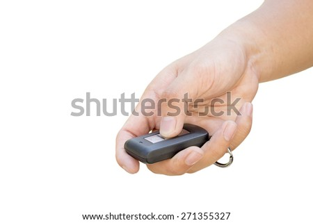 hand presses on the remote control car  - stock photo