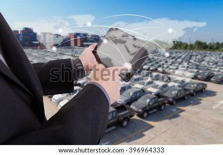 hand presses on world map with digital tablet,Business success strategy plan on container and car yard background (Elements of this image furnished by NASA) - stock photo