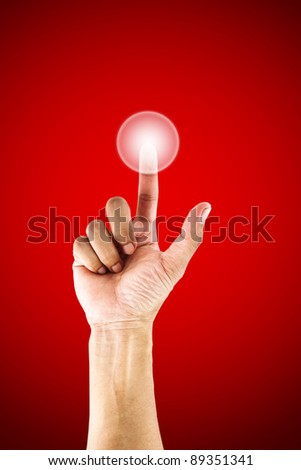 Hand pressing a button with index finger. - stock photo