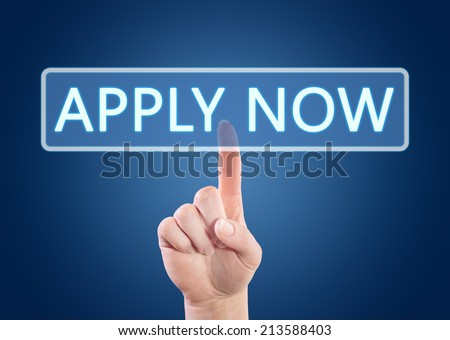 Hand pressing Apply now button on interface with blue background. - stock photo