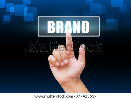 Hand pressing Brand button with technology background - stock photo