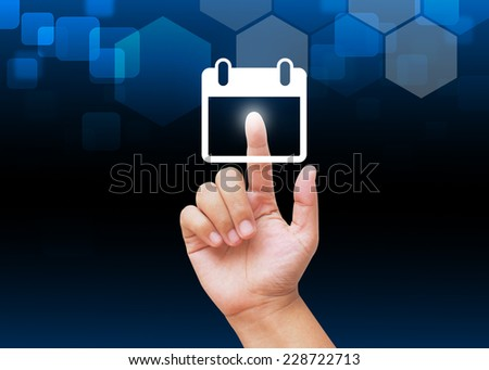 Hand pressing calendar buttons with technology background  - stock photo