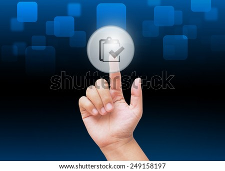 Hand pressing check sheet buttons with technology background  - stock photo