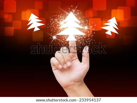 Hand pressing Christmas tree buttons on holiday background - stock photo