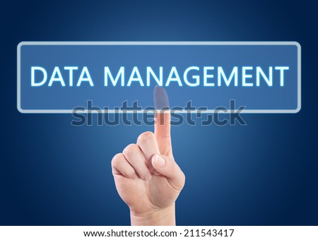 Hand pressing Data Management button on interface with blue background. - stock photo