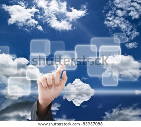 Hand pressing digital button on the blue sky field. - stock photo