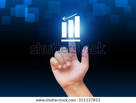 Hand pressing Graph down  button with technology background  - stock photo