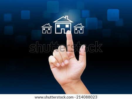 Hand pressing home buttons with technology background  - stock photo