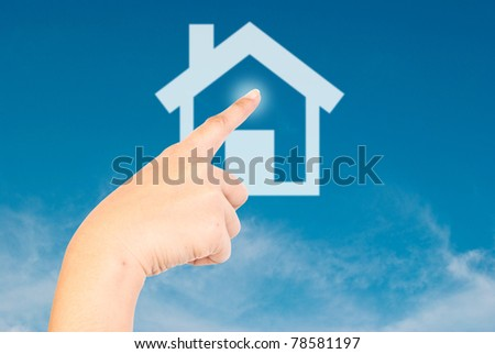 Hand pressing home on the blue sky. - stock photo