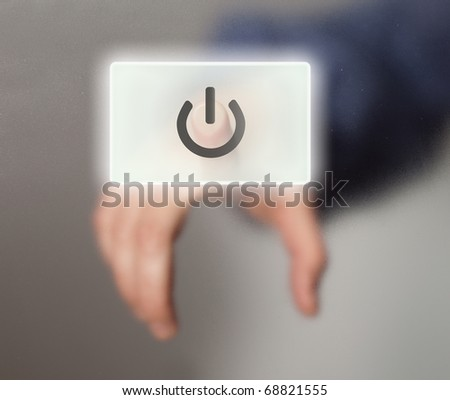 hand pressing ON/OFF button - stock photo