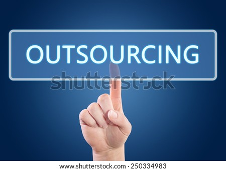 Hand pressing Outsourcing button on interface with blue background. - stock photo