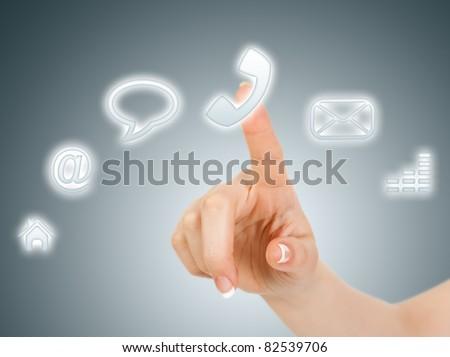 Hand pressing phone virtual button - stock photo