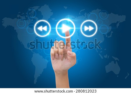 Hand pressing play button on the virtual background - stock photo