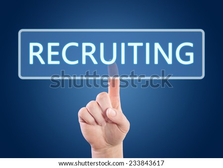 Hand pressing Recruiting button on interface with blue background. - stock photo